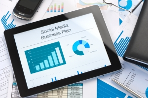 Social media business plan report on a digital tablet on a desk